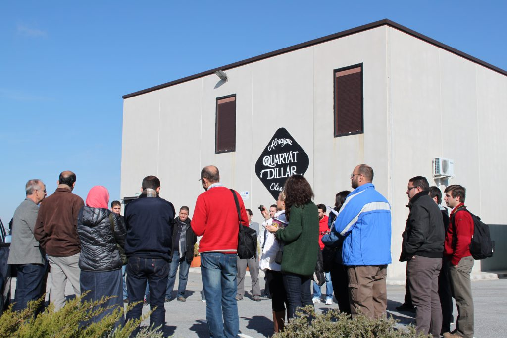 group of adults visit the Quaryat Dillar oil mill with the aim of learning about the processes and stages of extraction of a good extra virgin olive oil, the Sierra Nevada oil