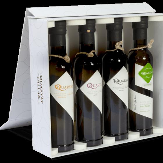 Four varieties extra virgin oilve oil pack Quaryat Arbequina, Quaryat Blend, Quaryat Picual y Quaryat Organic. Premium olive oil. White Sierra Nevada Box