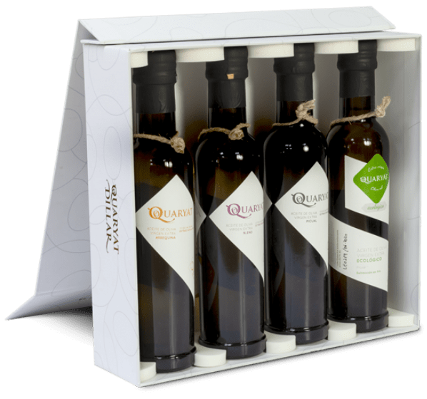 Four varieties extra virgin oilve oil pack Quaryat Arbequina, Quaryat Blend, Quaryat Picual y Quaryat Organic. Premium olive oil. White Sierra Nevada Box